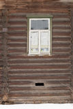 Window in the wall of an old wooden house Royalty Free Stock Images
