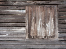 Window in the wall of an old wooden house Stock Photo