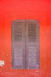 Window on wall. The window on red wall Stock Photos