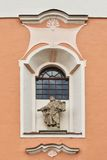 Window on the wall. Window and sculpture on the wall of the Czech church Royalty Free Stock Images