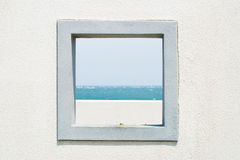 Window on the wall with  seascape and sky Royalty Free Stock Photography