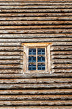 Window in wall. Window in the side wall of historic log cabin Stock Photography