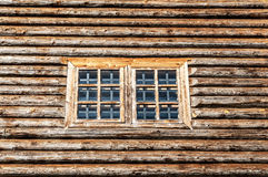 Window in wall. Window in the side wall of historic log cabin Stock Images