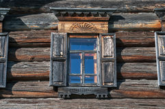 Window in wall. Window in the side wall of historic log cabin Royalty Free Stock Images