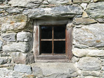 Window in wall of stone Stock Images