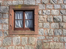 Window on wall of a stone house Royalty Free Stock Photos