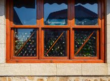 Window of a warehouse of empty wine glass bottles royalty free stock photography