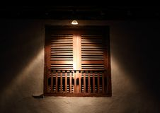 A closed window. The window was illumined by light Stock Photo