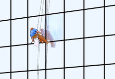 Window washer. A window washer on a skyscraper Royalty Free Stock Images