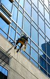 Window washer. On high rise royalty free stock photography