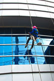 Window washer on the department store mirror. In asia royalty free stock photos