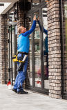 Window washer working  at building outdoor Stock Photo