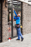 Window washer working  at building outdoor Royalty Free Stock Photo