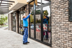 Window washer working  at building outdoor Royalty Free Stock Photography