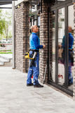 Window washer working  at building outdoor Royalty Free Stock Photos