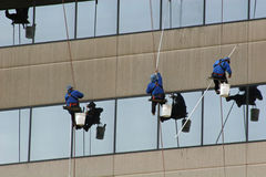 Window Washers 1. Window washers on side of highrise Royalty Free Stock Images