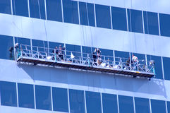 Window Washers 1. Three window washers on high rise Royalty Free Stock Image