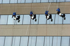 Window Washers 2. Window washers on side of highrise Royalty Free Stock Photo