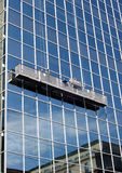 Window Washers. High rise window washers royalty free stock photo