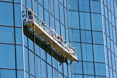 Window Washers. Window washing is a risky job Stock Images