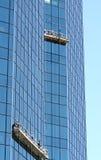 Window Washers. Window washing is a risky job royalty free stock image