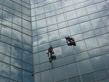 Window washers. Two window washers on a skyscraper in Fort Worth, Texas Royalty Free Stock Photos