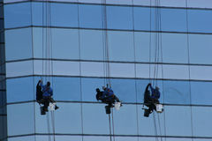 Window Washers 3. Window washers on highrise Stock Image