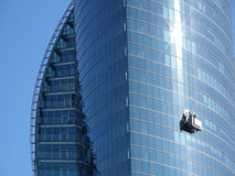 Window washers. Washing skyscraper stock images