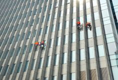Window washers cleaning the windows Royalty Free Stock Image