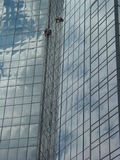 Window Washers High 1. Window washers on a skyscraper Royalty Free Stock Photos