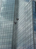 Window Washers High 5. Window washers on a skyscraper Stock Photography