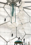 Window Washers inside the Water Cube. Workers hang from harnesses inside the Water Cube in Beijing's Olympic Park as they wash the windows inside the water park Stock Images
