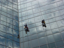 Window Washers Middle 2. Window washers on a skyscraper Stock Photo