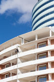 Window Washers on Modern Hotel Stock Photo