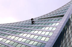 Window washers at a modern skyscraper Royalty Free Stock Images