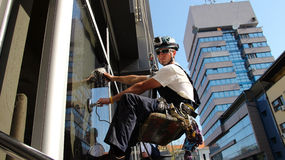 Window Washers on a Office Building stock photography