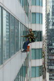 Window washers on skyscrapers in Toronto Canada. TORONTO, CIRCA MAY 2016.  Window washers on skyscrapers, as hazardous as the job appears, still attracts many Stock Photos