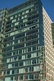 Window washers on South Boston office building. South Boston, Massachusetts, USA - April 14, 2016: Window washers making quick work of cleaning glass on Boston Stock Photos
