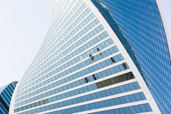 Window washers working. On skyscraper Stock Images