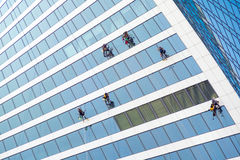 Window washers working. On skyscraper Stock Photos