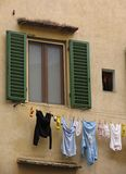 Window and washing. Washing hanging out to dry below a window Stock Image