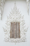 Window in Wat Rong khun is known among foreigners as the White Temple in Thailand. Window in Wat Rong khun is known among foreigners as the White Temple in Stock Photo