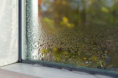 Window with water drops closeup, inside, selective focus Stock Image