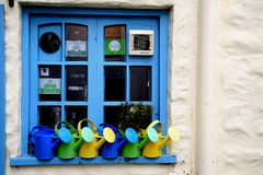 Window and watering cans, Royalty Free Stock Images