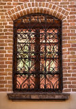 Window with well ornamented grill Royalty Free Stock Photo
