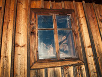 WIndow where the firewood live. Wooden stock image