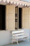 Window & white bench Stock Image