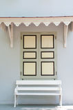 Window & white bench Stock Images
