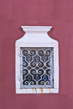 Window with white decorative grilles Royalty Free Stock Photos