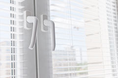 Window with white jalousie. Close up Stock Image